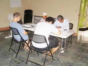 Discipleship group: Andres and Harold are seated on the opposite side of the table facing Jeff Roth and Emiliano.