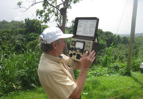 Lawrence Trumbower using a special meter while doing work for the radio station in Puerto Rico