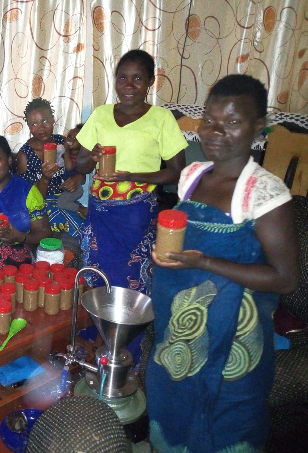 Impoverished Women – Making Peanut Butter